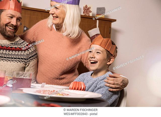 Happy grandmother, father and son during Christmas dinner