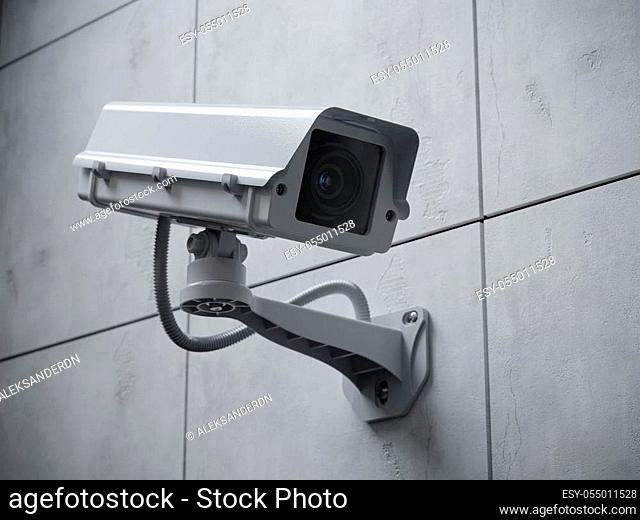 Security camera on the wall of a building. 3d render