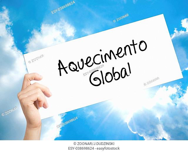 Aquecimento Global (Global Warming in Portuguese) Sign on white paper. Man Hand Holding Paper with text. Isolated on sky background