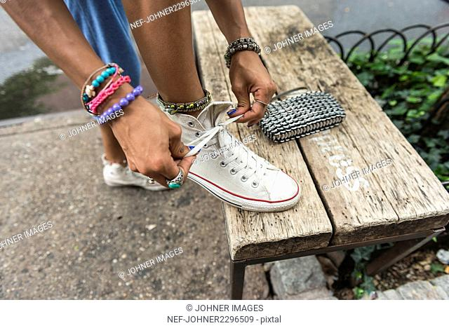 Woman lacing shoes
