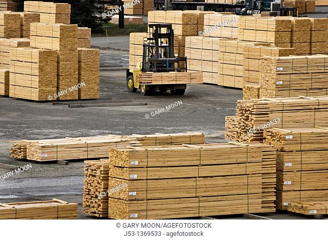 Fork lift moving lumber at sawmill, Coos Bay, Oregon