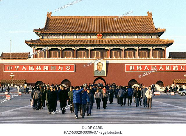 China, Beijing, Tiananmen Square with group of people walking in front A72D