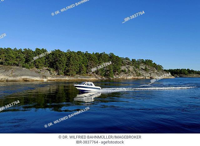 Motorboat off the island of Soder Langjolm, viewed from Finnhamn Island, Stockholm Middle Archipelago, Stockholm, Sweden