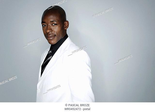 Portrait of a businessman smirking