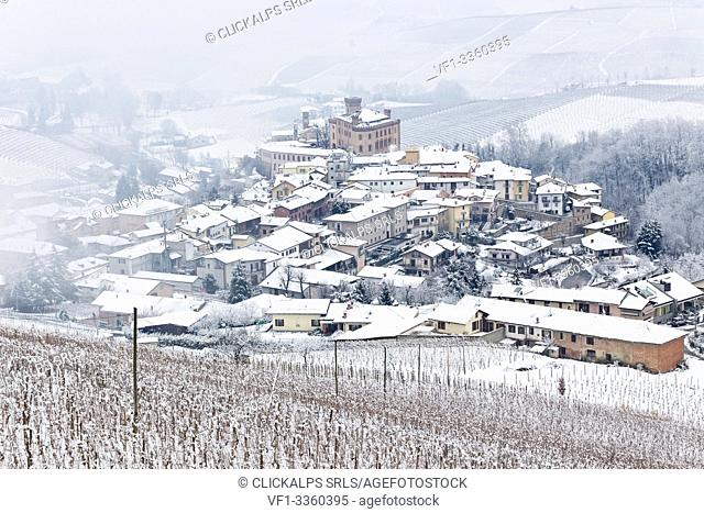 Langhe, Cuneo district, Piedmont, Italy. Langhe wine region winter snow, Barolo castle