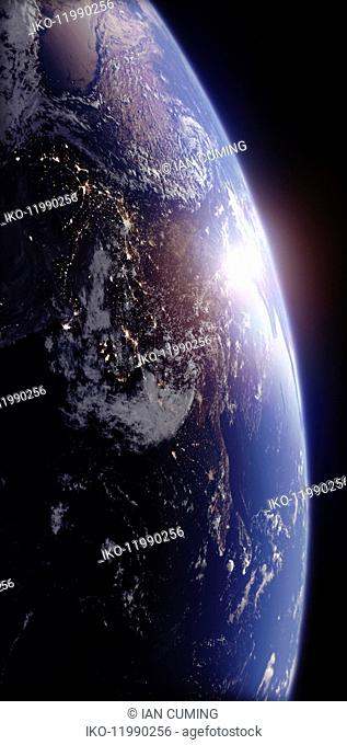 Sun rising over India from space