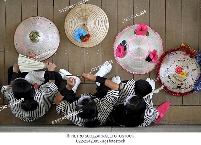 Naha, Okinawa, Japan: young women dressed in traditional Okinawan costume at the 10.000 Eisa parade along Kokusai-dori