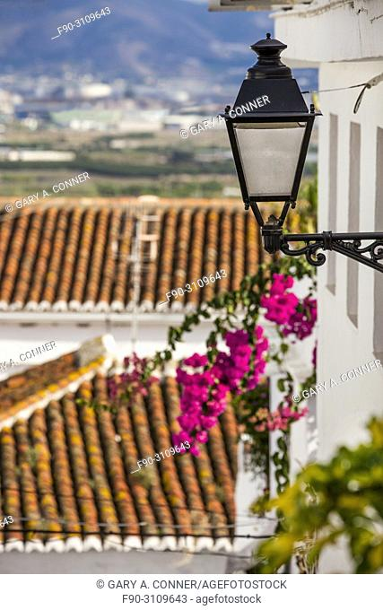 Streetlight with bougainvillea blooms in Salobreña, Granada, Spain