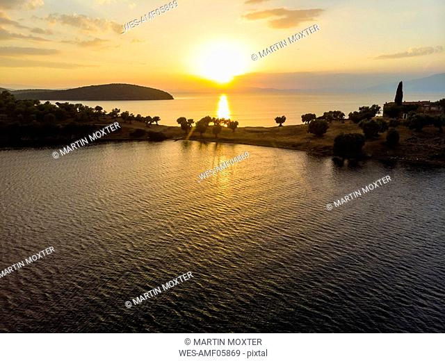 Greece, Aegean Sea, Pagasetic Gulf, Peninsula Pelion, Sound of Trikeri, Aerial view from Bay of Milina to Island Alatas with Holy Forty Monastery at sunset