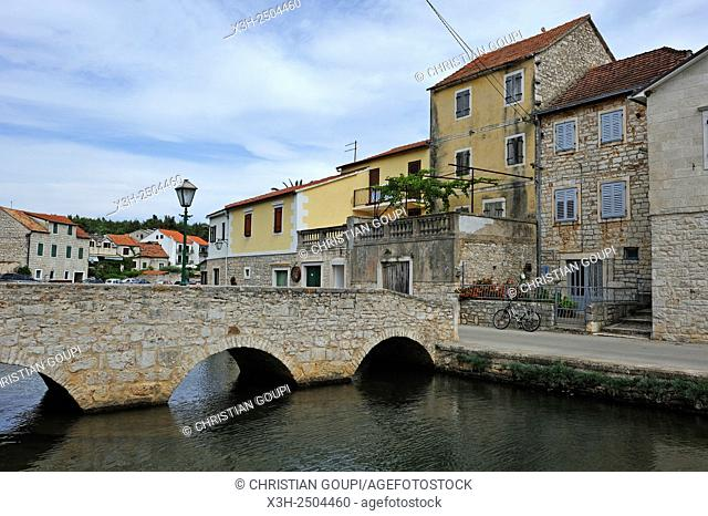 stone bridge over the canal at Vrboska, Hvar island, Croatia, Southeast Europe