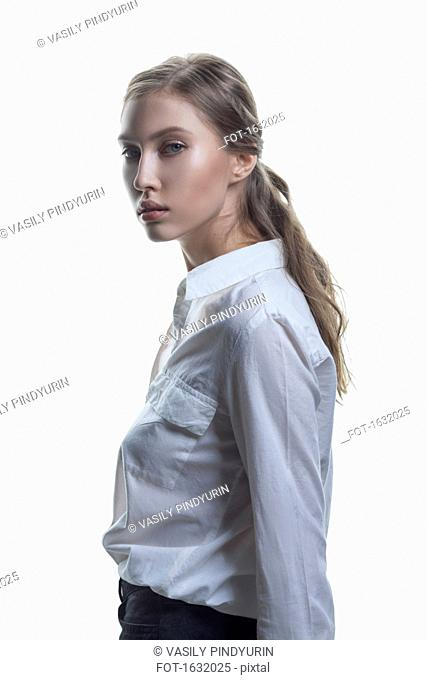 Side view portrait of beautiful fashion model against white background