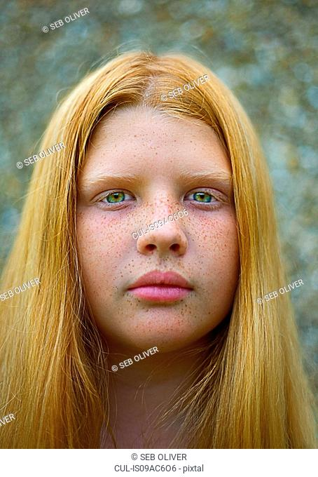 Portrait of teenage girl with red hair