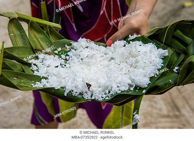 Coconut served on a palm leaf. Bora Bora, French Polynesia