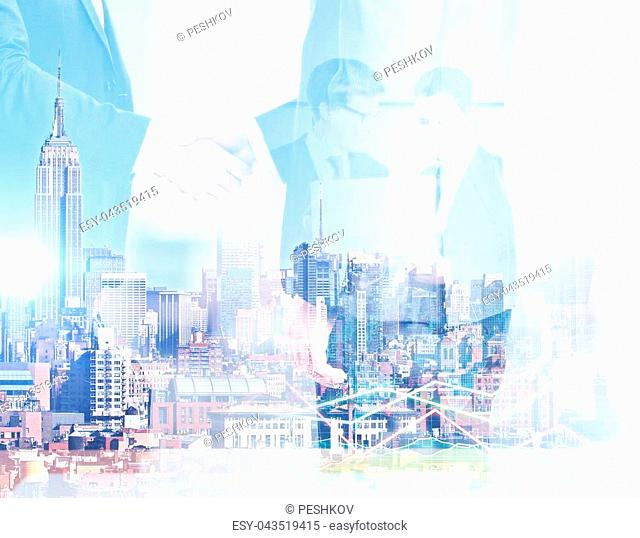 Abstract image of businessmen using laptop and shaking hands on city background. Digital business concept. Double exposure