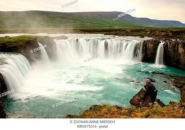 Godafoss waterfall man looking
