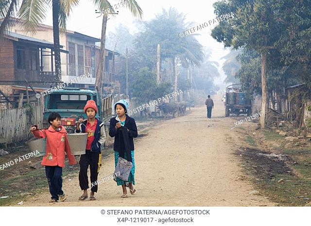 Childen on the way to get water. Sinbo, Myanmar