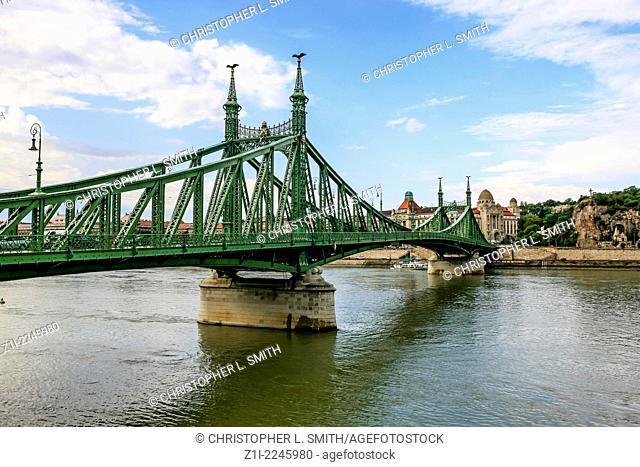 The green zabadsag bridge over the river Danube in Budapest