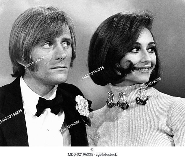 Dancer and presenter Raffaella Carrà with Italo-French artist Nino Ferrer during the TV broadcast Io, Agata e tu. Roma, March 1970