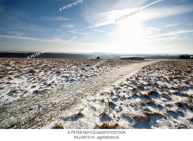 hillside with light covering of snow and wide views of surrounding area