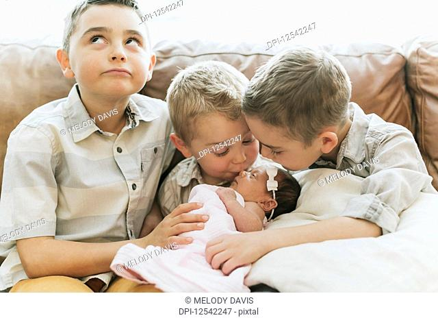 Three young boys with their newborn baby sister; Surrey, British Columbia, Canada