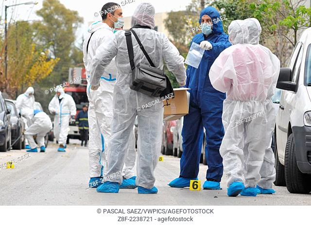 30 December 2010 - Athens, Greece - Forensic police officers gather evidence at the scene of a bomb attack on a court building in the centre of Athens