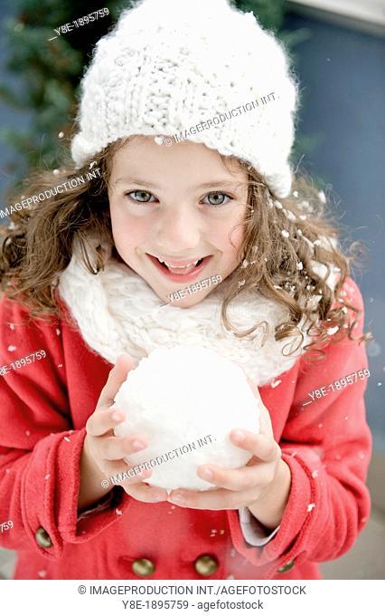 Czech Republic, Pretty girl (4-5) with snowball