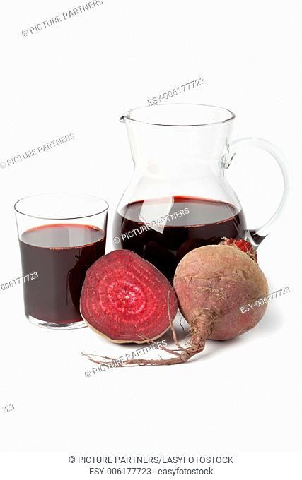 Fresh juice of red beets on white background
