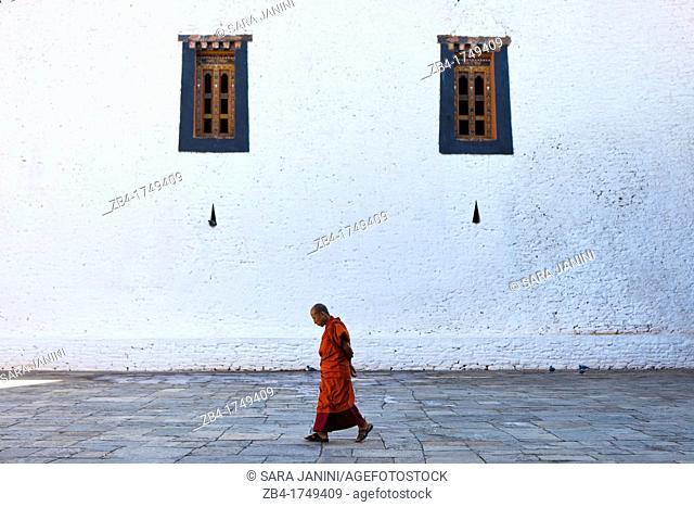 Monk walking inside Punakha Dzong, Punakha, Bhutan, Asia
