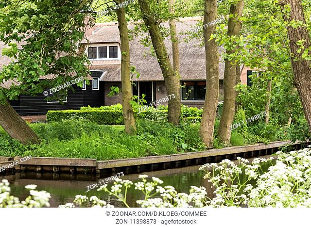 Giethoorn, The Netherlands - May 19., 2016: Thatched monumental house in the small, picturesque town of Giethoorn, Overijssel, Netherlands
