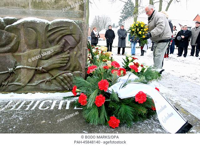 Politicians, citizens and pupils place wreath and flowers at the concentration camp memorial in Ludwigslust, Germany, 27 January 2014