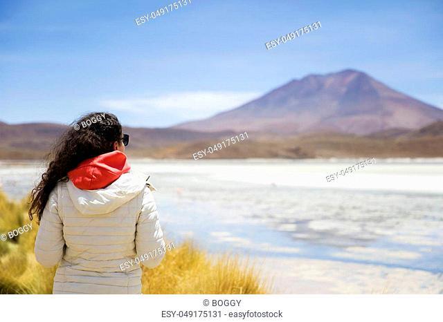 Young woman at Laguna Hedionda at Eduardo Avaroa Andean Fauna National Reserve in Bolivia
