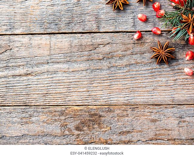 Pomegranate star anise nuts, cinnamon and winter spices on a gray concrete background