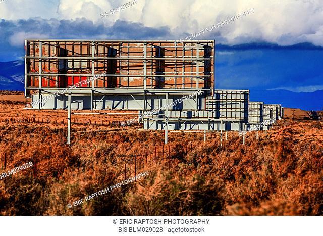 Backside of billboards along landscape