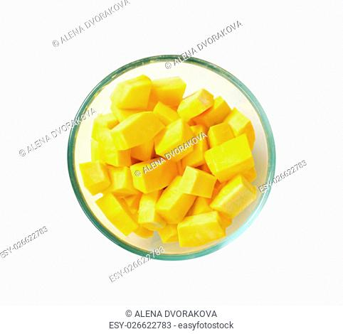 diced yellow pumpkin in a glass bowl