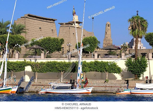 Egypt, Upper Egypt, Nile Valley, Luxor, feluccas on the Nile River moored in front of the temple