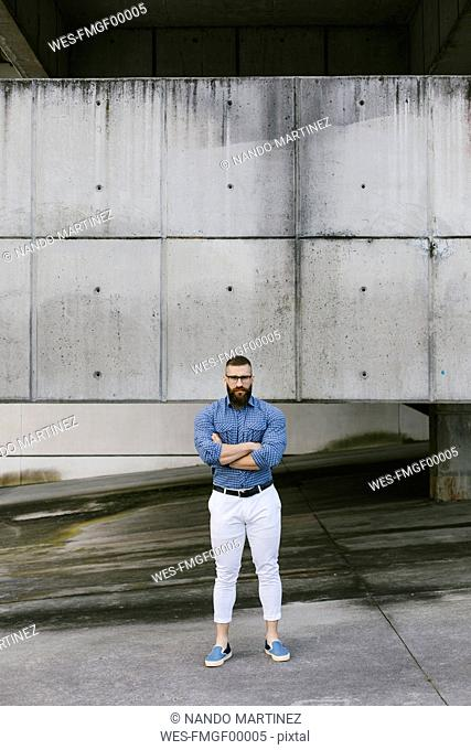 Bearded hipster businessman with arms crossed