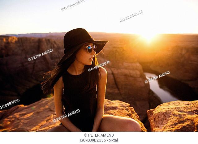 Woman relaxing and enjoying view, Horseshoe Bend, Page, Arizona, USA