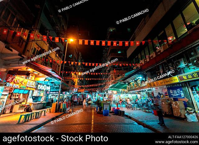 Hong Kong and China flag bunting hanging across street