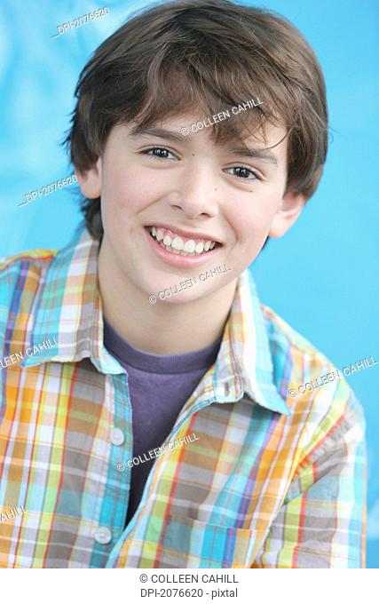 Portrait of a boy with brown hair and brown eyes wearing a plaid shirt, troutdale oregon united states of america