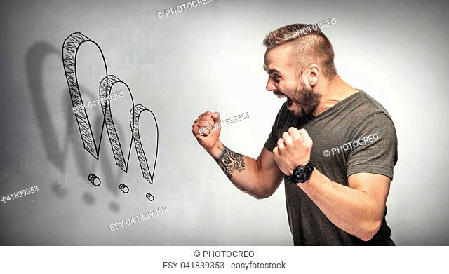 Angry man shouting with tightened fists. Exclamation marks emphasizing his fury. Rage concept
