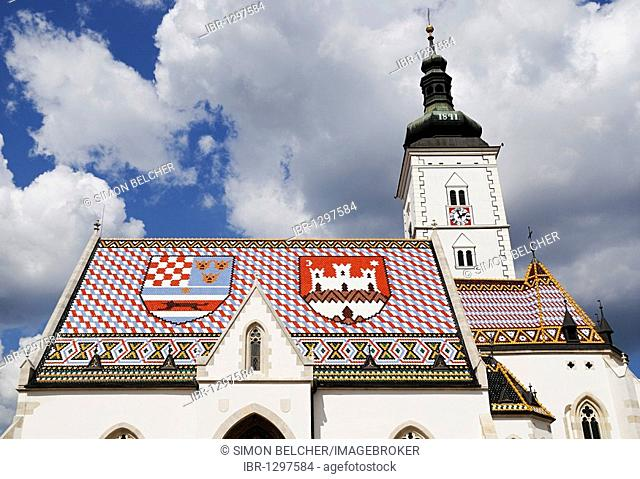 St Marks Church with coat of arms of Zagreb on the right and the shield of the Triune Kingdom of Croatia, Slavonia, and Dalmatia on the left of its tiled roof