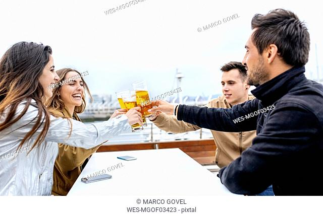 Group of friends toasting with beer