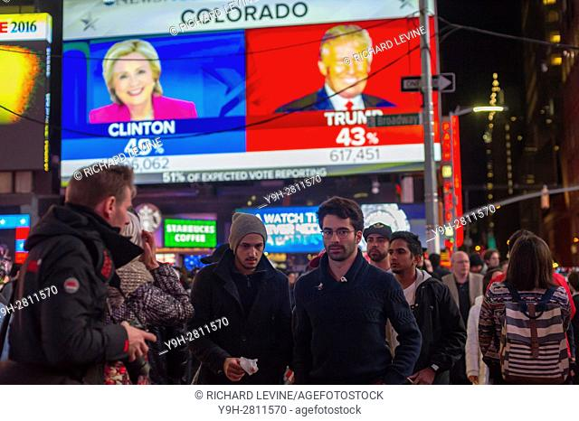 Visitors to Times Square in New York watch the election returns on giant screens on the evening of Election Day, Tuesday, November 8, 2016