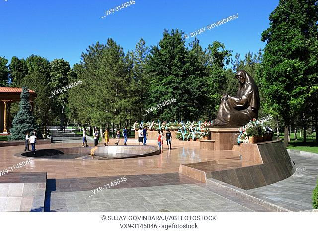 Tashkent, Uzbekistan - May 12, 2017: Children visiting Crying Mother monument and eternal flame at Independence square