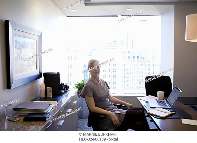 Portrait confident female lawyer at desk in office