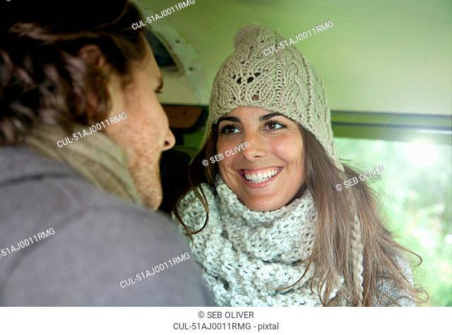 Smiling couple sitting in van