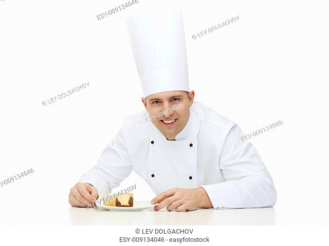 cooking, profession, haute cuisine, food and people concept - happy male chef cook with dessert