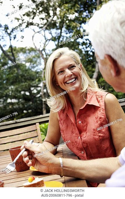 Mature woman looking at a mature man and smiling