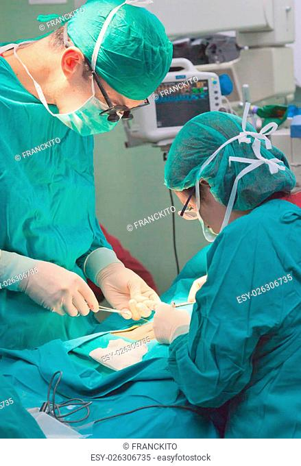 medical team performing surgery on a patient