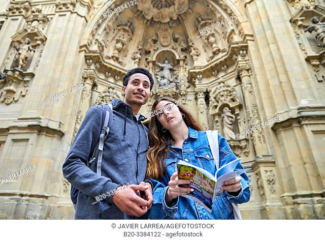 Couple of tourists visiting the city, Multiracial young couple, Basilica de Nuestra Señora del Coro, Parroquia de Santa María, Donostia, San Sebastian, Gipuzkoa